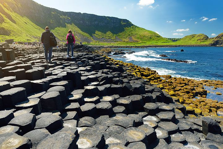 Giants-Causeway-Official-Guide-The-Causeway-looking-back-towards-the-cliff-with-people-on-it