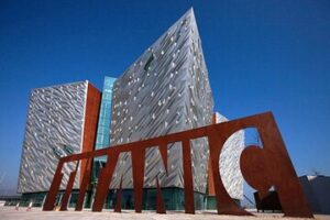Titanic Belfast Museum with giant titanic sign in front